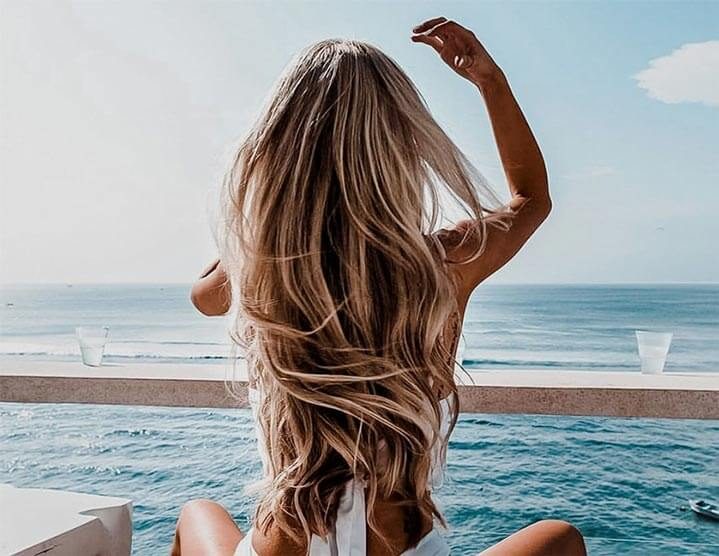 woman at the beach with long hair